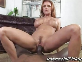 older brunette with super boobs rides brown meat