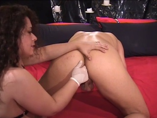 nasty milf brunette banging hunk with strapon
