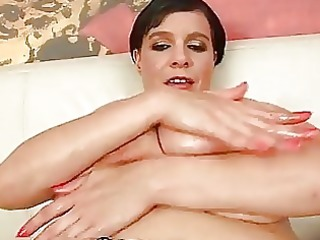 cougar laurella pushing dildo with her big breast