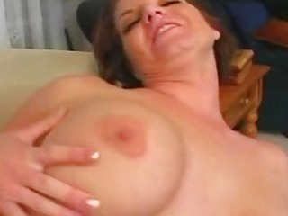 little haired brunette momma with large boobs