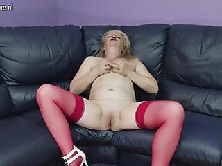 nasty elderly grandma dildoing on the couch