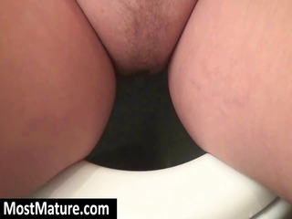 plump blonde babe goes pee and gets a bathroom