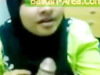 devout pakistani wife in dark burqa tasting small