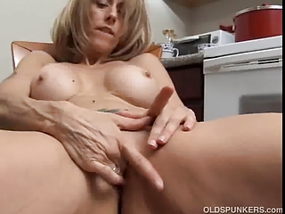 busty mature lady with giant nipples strokes her