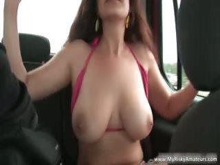 brunette lady exposing her huge
