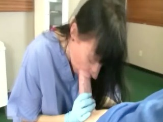 doctor lady is licking her patients penis and
