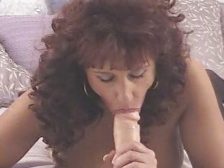 mature red-haired sucking a dildo