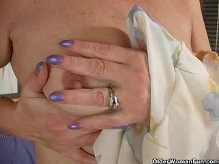 redheaded elderly pleases her hirsute vagina