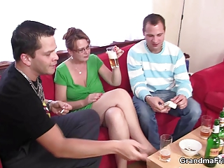 hot cougar babe takes two penises at once