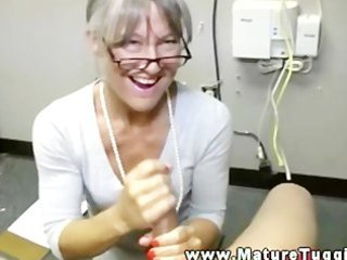 awesome older lady takes on her knees to jerk