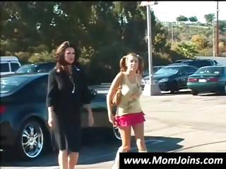 brunette woman and young are being picked up and