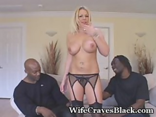 blonde babe engulfs two black studs