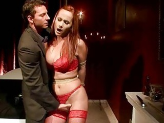 desperate redheaded lady gets bondaged and pierced