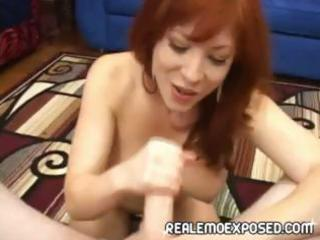 naughty redheaded babe strips, gives a point of