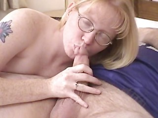 bleached cougar girl putting on glasses blows and