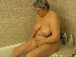 awesome elderly having fun into the shower