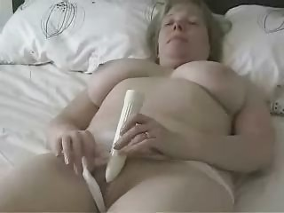 huge boobed older mom pushing dildo with a