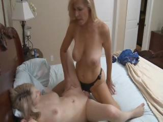 awesome blond older lady uses a strapon to fuck