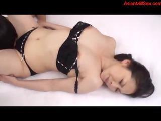woman inside dark lingerie obtaining her breast