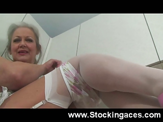 stunning cougar bitch fucks herself in kitchen