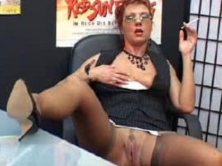gorgeous mature secretary smokes and fist vagina