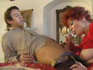 rufous old spreads her stockinged foot and gets