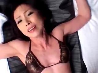lean milf with small boobs in bikini taking her