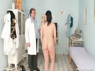 horny gyno nurse examines the hirsute vagina of