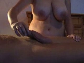 buxom wife gives her man a oily handjob