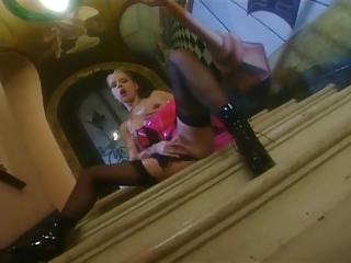 milf pleases in a latex dress nylons and boots