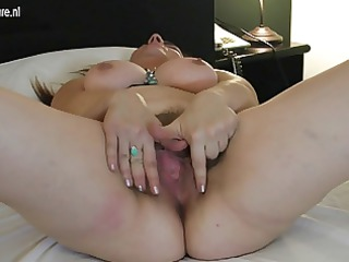slutty cougar woman takes her hairy pussy wet