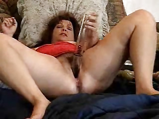 pervert cougar whore has pleasure with her toys.
