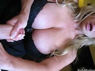 hot boobed babe giving a hot handjob