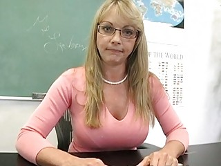 blonde grown-up teacher demonstrates off her