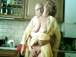 se mum and dad having pleasure in the kitchen.