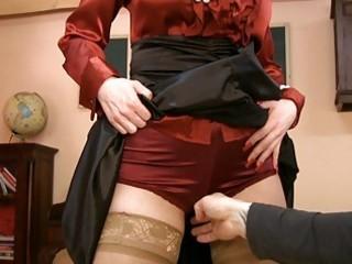 older girl inside glasses and satin stockings