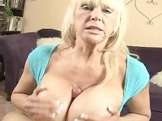 tanned blonde momma with very big hooters doing