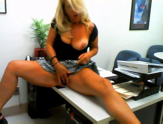slutty woman masturbates into her workplace
