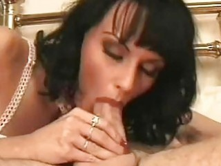 sweet black haired woman licks and sucks clean