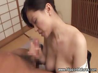 bigbreasted geisha gives client a titjob