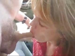 mature babe taking a facial cum inside open-air