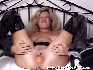 young woman inside pvc with giant dildo