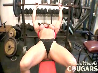mature muscular woman enjoys with giant clit